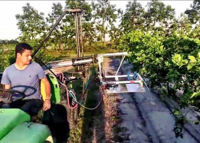 Victor Partel, a researcher at University of Florida, tests a new system to detect psyllid bugs that transmit disease to citrus trees. Photo courtesy of UF-IFAS.