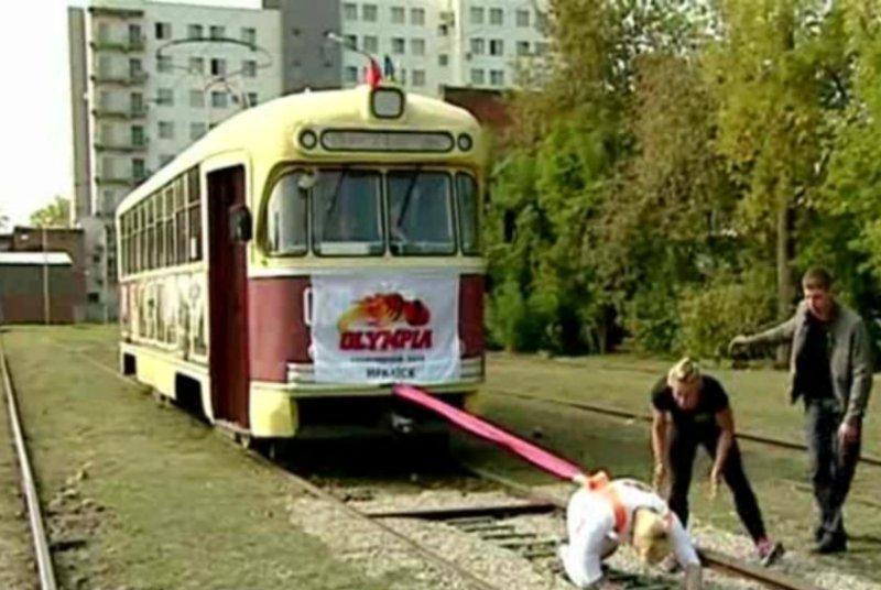 Oksana Kosheleva pulls an 18.7-ton tram car a distance of 16.4 feet. ITN video screenshot
