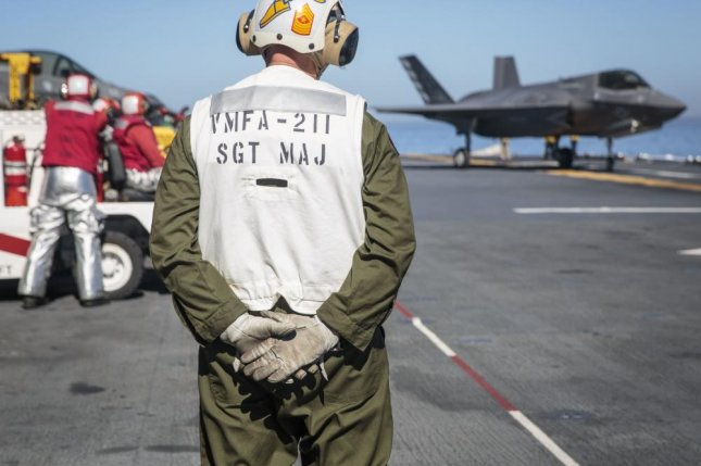 U.S. Marine Sgt. Maj. Allen Goodyear, the squadron sergeant major for Marine Fighter Attack Squadron 211, Marine Aircraft Group 13, 3rd Marine Aircraft Wing, waits for an F-35B Lightning II to get into takeoff position aboard the USS Essex during Exercise Dawn Blitz, Oct. 24, 2017. Photo by Sgt. April L. Price/U.S. Marine Corps