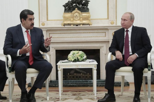 Russian President Vladimir Putin (R) and Venezuelan President Nicolas Maduro (L) speak during their meeting at the Kremlin in Moscow Wednesday. Photo by Sergei Chirikov/EPA-EFE