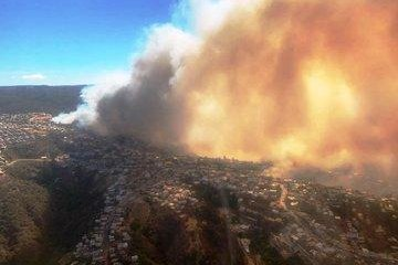 At least 200 homes have been destroyed by a wildfire on the outskirts of Valparaiso, a coastal Chilean city. Photo courtesy of Chilean Agriculture Minister Antonio Walker/Twitter