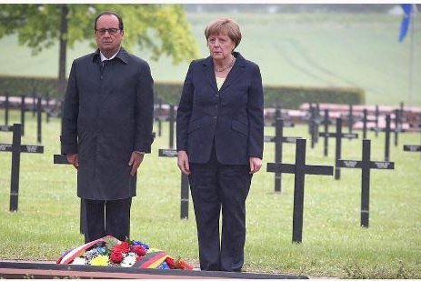 French President Francois Hollande and German Chancellor Angela Merkel laid a wreath at a military cemetery in Consenvoye, near Verdun, where 11,148 German soldiers are buried. Photo from French president's office/Instagram