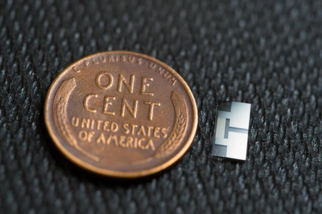 Scientists built the new ultrasound device using off-the-shelf smartphone components. The tiny technology can produce extremely high frequencies, from 100 million to 10 billion hertz. Photo by David Baillot/University of California San Diego