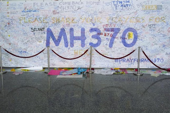 A memorial full of supportive messages and prayers grew inside Malaysia's Kuala Lumpur International Airport after Malaysia Airlines Flight 370 disappeared somewhere in the Indian Ocean. A Malaysian court on Wednesday rejected the airliner's bid to have a lawsuit against it thrown out. File photo by AHMAD FAIZAL YAHYA/Shutterstock