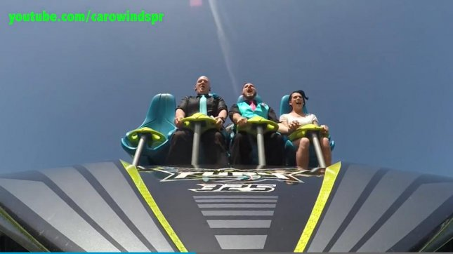 A North Carolina couple exchange vows on the Fury 325 roller coaster at Carowinds amusement park. Screenshot: Charlotte Observer