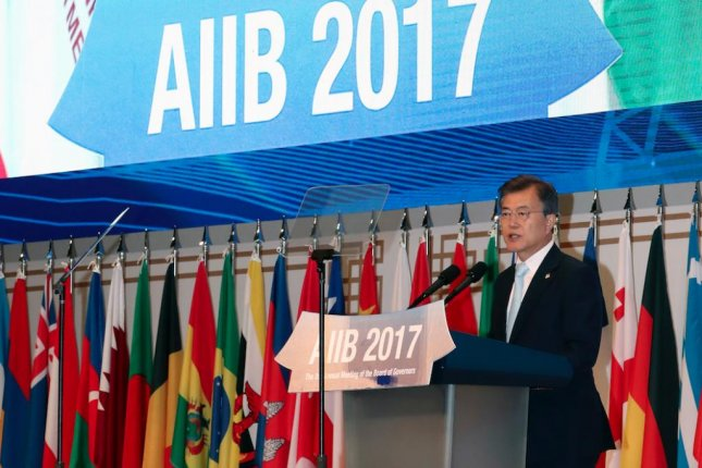 South Korean President Moon Jae-in speaking at the second annual AIIB board of governors meeting in Jeju Island, South Korea on Friday. Photo by Yonhap/EPA
