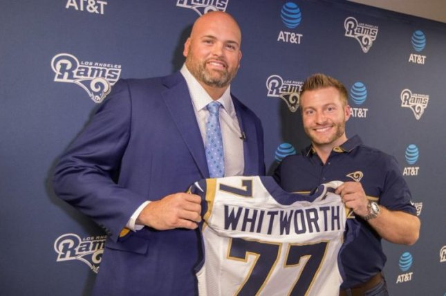 Los Angeles Rams offensive tackle Andrew Whitworth (L) will donate his game check to victims and the families of this week's shooting in Thousand Oaks, Calif. Photo courtesy of Los Angeles Rams/Twitter