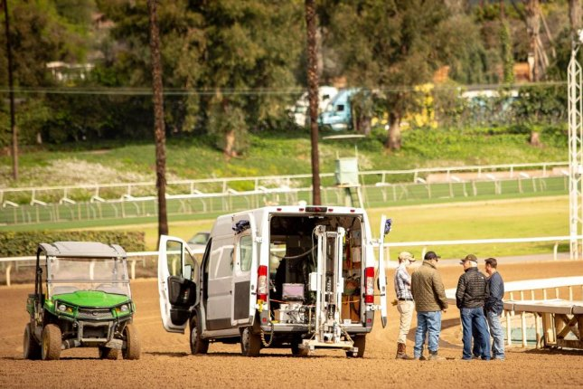 Santa Anita officials and expert consultants examine the racing surface earlier this week in search of reasons for fatal injuries this season. Santa Anita photo