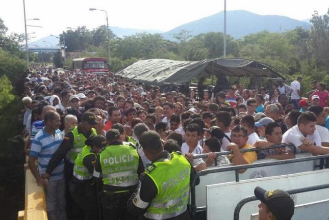 Up to 35,000 Venezuelans crossed from San Antonio del Tachira to Colombia's town of Cucuta on Sunday to purchase basic foods and medicines. The shared border has been closed since August. Photo courtesy of Metropolitan Police of Cucuta