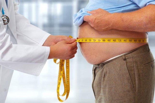 A four-inch difference in waist size -- from 33 inches to 37 inches -- was linked to a 13 percent increase in risk for aggressive prostate cancer, according to researchers at the University of Oxford. Photo by kurhan/Shutterstock