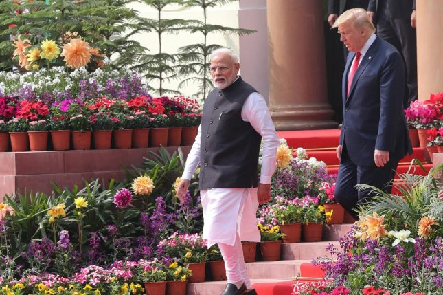 Indian Prime Minister Narendra Modi walks with US President Donald J. Trump on their way to address the media after a meeting at Hyderabad House in New Delhi, India, Tuesday. The two announced a $3 billion sale of U.S.-made helicopters for use by the Indian Army. Photo by Harish Tyagi/EPA-EFE