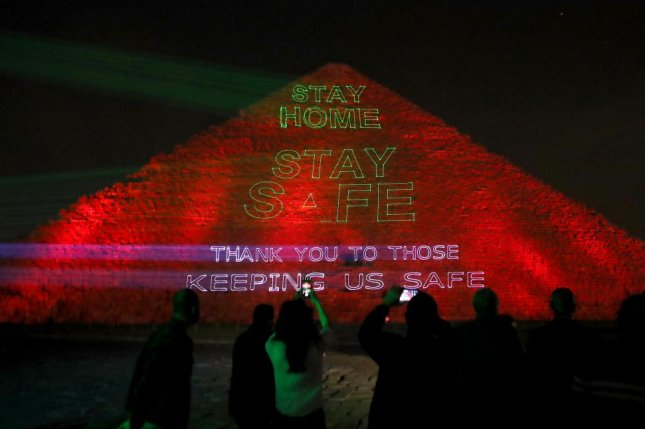 Messages are projected onto the Great Pyramid near Cairo, Egypt, on Monday, which pay tribute to front-line workers and caution residents to stay home. Photo by Khaled Elfiqi/EPA-EFE