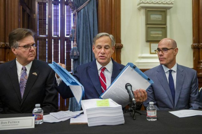 From left to right, Texas Gov. Greg Abbott, Lt. Gov. Dan Patrick and House Speaker Dennis Bonnen hold the first meeting of the Texas Safety Commission at the state Capitol on August 22. Photo by Marjorie Kamys Cotera for The Texas Tribune
