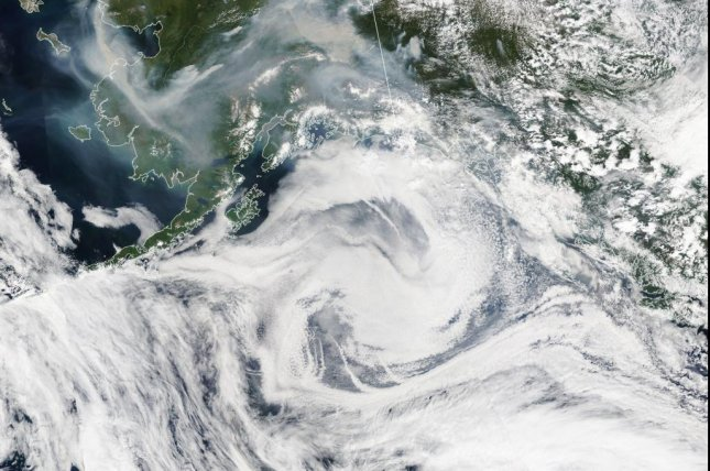 A NASA Earth Observatory satellite image showing thick wildfire smoke swirling over Alaska on July 8, 2019. Scientists said this week some of those fires smoldered underground all winter and have now returned as so-called zombie fires. Photo by NASA Earth Observatory/EPA-EFE