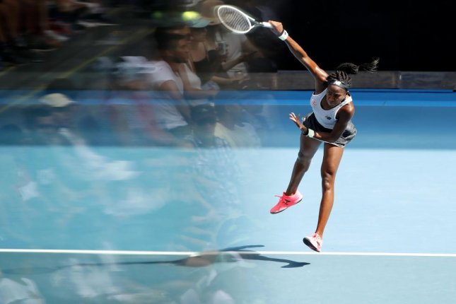 This is a multiple exposure of Coco Gauff playing Sofia Kenin at the Australian Open Grand Slam tennis tournament in Melbourne on Sunday. Photo by Francis Malasig/EPA-EFE