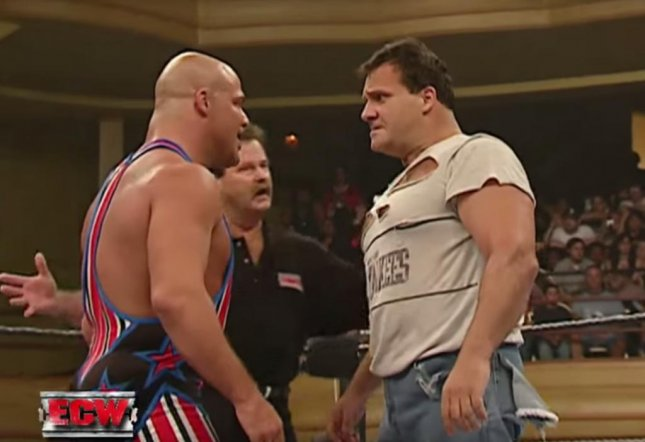 The Brooklyn Brawler (L) facing off against Kurt Angle (R) during a broadcast of ECW on August 1, 2006. The Brooklyn Brawler has reportedly been released by WWE. Photo courtesy of WWE/Youtube