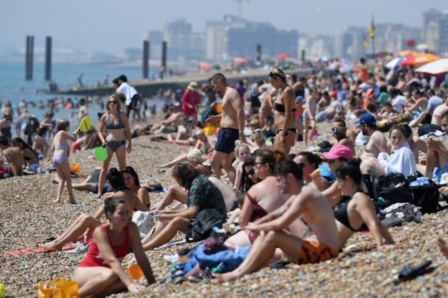 Bathers at Brighton Beach in Brighton, Britain, attempt to escape the record heat. Photo by Andy Rain/EPA