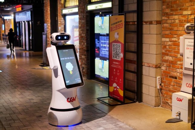 Checkbot, an AI-powered robot, takes tickets, answers questions and gives directions at CGV's contact-free untact cinema in Seoul. Photo by Thomas Maresca/UPI