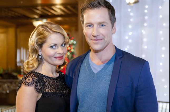 A Christmas Detour, starring Candace Cameron Bure (L) and Paul Greene, and other holiday movies will broadcast March 20-22 on the Hallmark Channel. Photo courtesy of Hallmark Channel