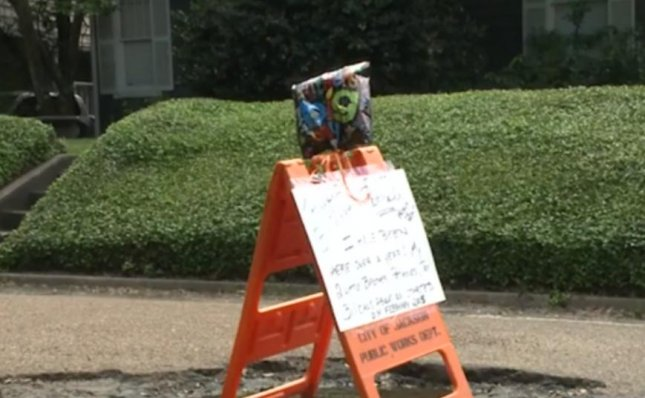 The city of Jackson, Miss. sent workers to fill a nearly 2-year-old pothole after residents held a birthday celebration for the road hazard. Devine St. resident Eddie Prosser placed a sign and balloons near the large pothole and its two little brothers after they had been in the neighborhood for 16 months. Within a few days city workers filled the potholes with dirt as residents hope they will soon be paved over. 