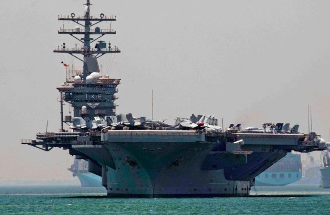 The aircraft carrier USS Dwight D. Eisenhower, pictured, and the guided missile destroyer USS Mitscher arrived at Duqm, Oman, for a weekend port visit. Photo by MCS Seaman Darren Kenney/U.S. Navy