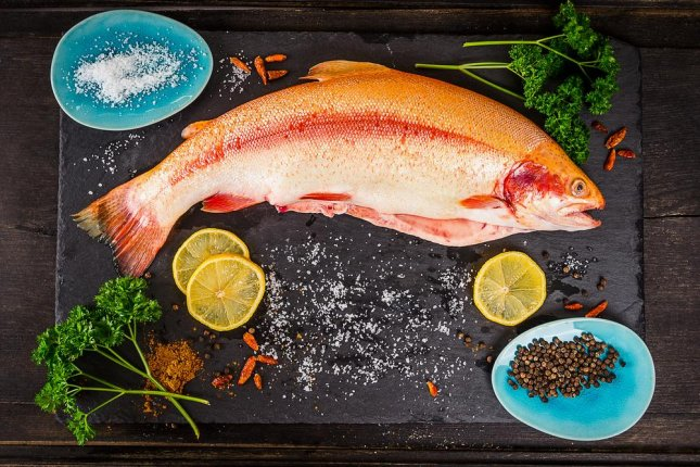 Rainbow trout, above, is among the fish the FDA says is safer for women to eat during pregnancy. The agency recommends pregnant women limit fish consumption to 8 to 12 ounces, or two to three servings, per week. Photo by VICUSCHKA/Shutterstock