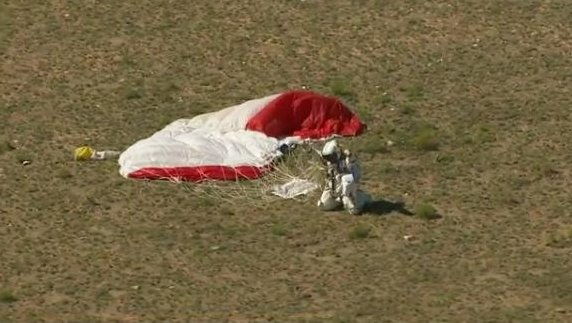 Austrian skydiver Felix Baumgartner lands safely on Earth after breaking the world record for highest and fastest free fall from over 120,000 feet.