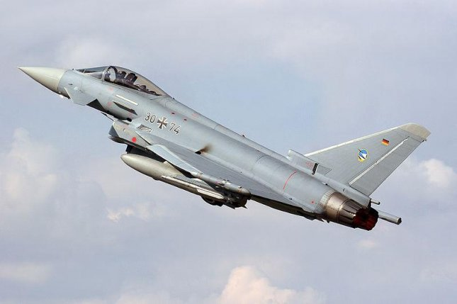 A German Air Force Typhoon S fighter plane. Photo from Wikimedia/Curimedia Photography. https://commons.wikimedia.org/wiki/File:Eurofighter_Typhoon_S_Germany_Air_Force_30-74_(9628012887).jpg