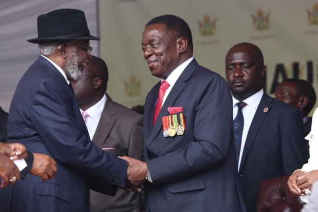 Emmerson Mnangagwa, appearing in the center of the photo, was sworn in as Zimbabwe's second president since independence on Friday. Photo by Aaron Ufumeli/European Pressphoto Agency
