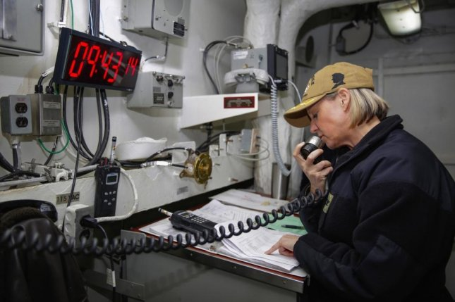 Capt. Amy N. Bauernschmidt, pictured reading the petty officer advancement results over the USS Abraham Lincoln's announcement system in Nov. 2018, has been named commanding officer of the aircraft carrier. Photo by Gwendelyn Ohrazda/U.S. Navy