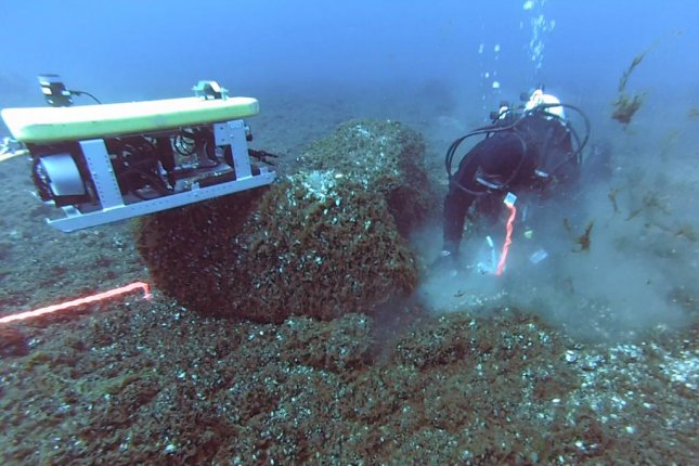 Diver and remote operated vehicle collecting samples at Drop 45 Drive Lane in Lake Huron. (University of Michigan)
