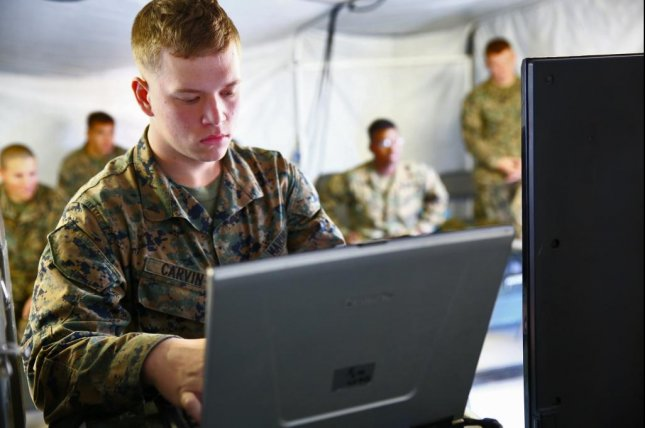 Lance Cpl. Shawn E. Carvin, wireman, Communications Company, Combat Logistics Regiment 15, 1st Marine Logistics Group, practices programing during a class on radio programing aboard Camp Pendleton, Calif. U.S. Marine Corps photo by Cpl. Timothy Childers
