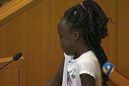 A young girl, Zianna Oliphant, was among the dozens of speakers who addressed their concerns at a Charlotte CIty Council meeting one week after the shooting of a black man by a police officer. It's a shame that our fathers and mothers are killed and we can't see them anymore, she said as tears streamed down her face. Screenshot from WSOC TV.