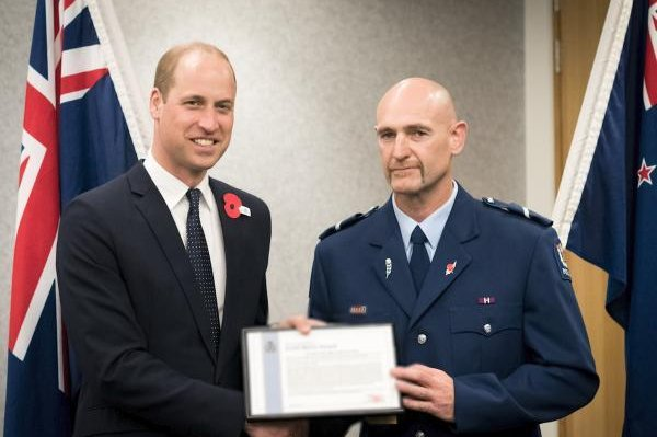 Prince William, Duke of Cambridge, presents Senior Constable Scott Carmody with the Commissioner's Gold Merit Award for his efforts to arrest the man accused of killing 51 people during the Christchurch shooting in March. Photo courtesy of New Zealand Police/Website