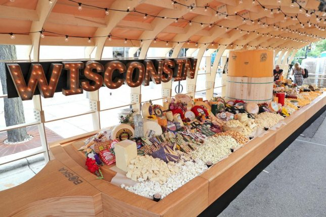 The Dairy Farmers of Wisconsin broke a Guinness World Record for the world's largest cheeseboard in Madison. Photo courtesy of Dairy Farmers of Wisconsin