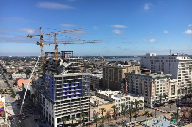 The city of New Orleans on Sunday plans to demolish two cranes after the collapse of two floors at the Hard Rock hotel construction site last week. Photo courtesy New Orleans Fire Department/Twitter