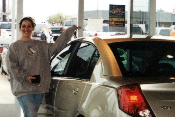 Candice Anderson with her new Saturn Ion. On Nov. 15, 2004, the car would crash, killing her fiancé. The accident has been linked to faulty ignition switches in millions of GM vehicles. UPI/Robert Hillard