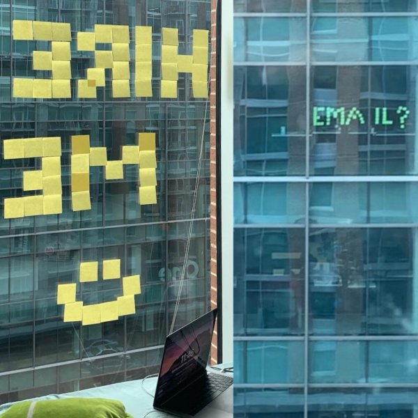 A Georgia Tech student whose apartment window faces a tech company's headquarters used sticky notes to seek a job with the firm. Photo courtesy of Georgia Tech