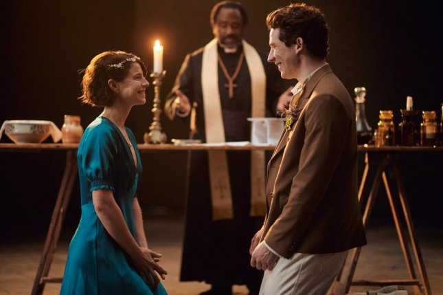 Friar Lawrence (Lucian Msamati, center) marries Juliet (Jessie Buckley) and Romeo (Josh O'Connor, right) in secret. Photo courtesy of PBS