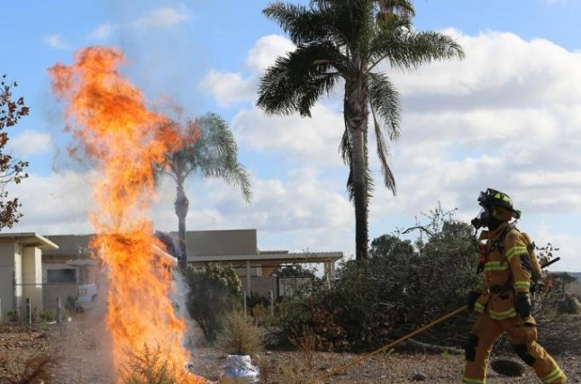 Firefighters with the Miramar Fire Department dropped an ice-cold turkey into a fryer overfilled with the wrong oil and heating at the wrong temperature. Marine Corps Air Station Miramar photo by Sgt. Melissa Wenger.
