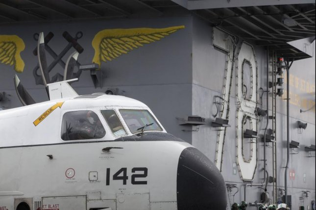 A C-2A Greyhound, assigned to Air Test and Evaluation Squadron 20, prepares to move across the flight deck of the aircraft carrier USS Gerald R. Ford. Photo byAngel Thuy Jaskuloski/U.S. Navy