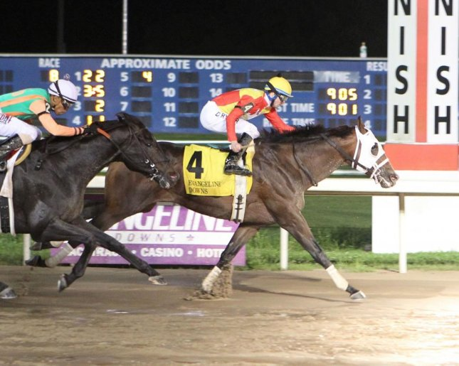 Fear the Cowboy wins Saturday's $100,000 Evangeline Mile in Louisiana. Photo by Evangeline Downs/Coady Photography