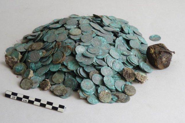 The silver coins were found enclosed in a hide sack and buried at the Cluny Abbey. Photo by Anne Baud-Anne Flammin-Vincent Borrel/CNRS