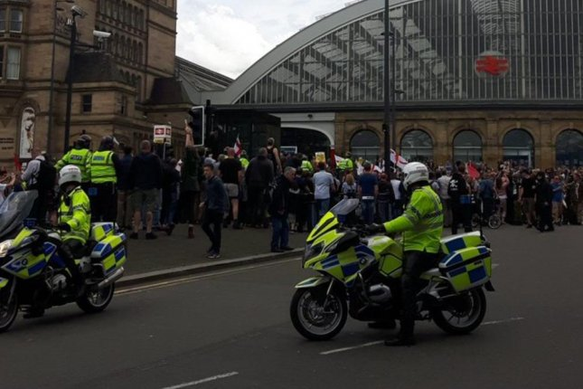 Merseyside police disperse crowds of far-right and left-wing demonstrators clashing in the city center of Liverpool, England, on Saturday. Photo by Merseyside Councilor Sean Donnelly/Twitter