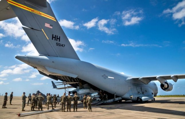Military personnel arrive at Marine Corps Air Station Futenma on Okinawa, Japan. Okinawa's governor said the U.S. military is not doing enough to control a COVID-19 outbreak at bases on the island. Photo courtesy of U.S. Marine Corps