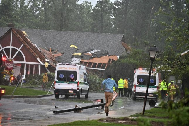 Emergency crews in Bucks County, Pa., respond to a damaged home and downed power lines on Tuesday after Tropical Storm Isaias passed through the area. Photo courtesy Bucks County Government/Twitter