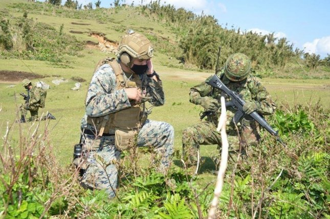 U.S. Marines conduct field maneuvers in Japan during Keen Sword 21, and 11-day exercise involving 9,000 U.S. troops and 37,00 members of the Japan Self-Defense Force. Photo courtesy of U.S. Marines