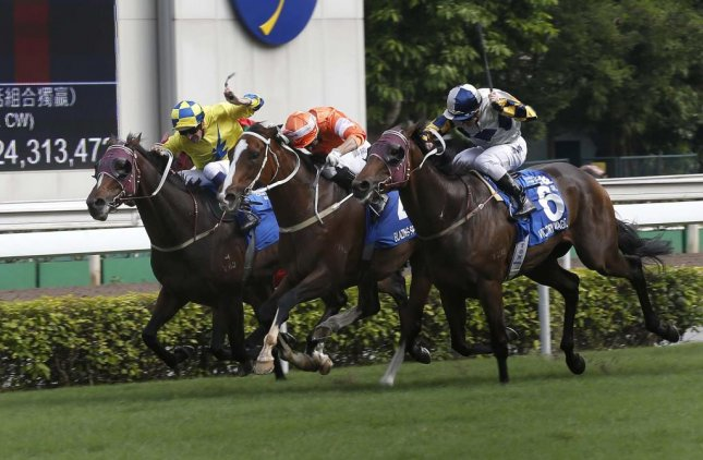 Blazing Speed (center, orange silks), narrowly edges Victory Magic and Werther in Sunday's Group 1 Standard Chartered Champions & Chater Cup at Sha Tin in Hong Kong. Photo by HKJC