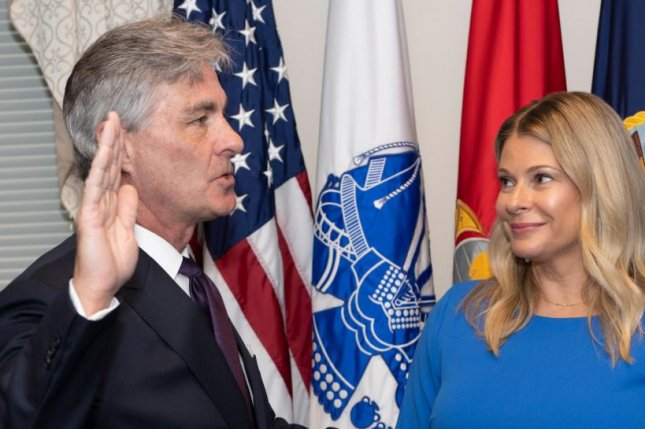 Kenneth J. Braithwaite (L), here with his wife, Melissa, was sworn in Friday as the 77th Secretary of the U.S. Navy.  Photo courtesy of Mark Esper/Defense Department Twitter