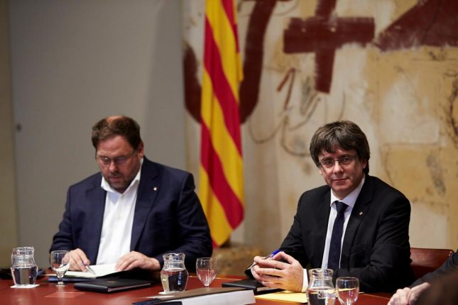 Catalonia President Carles Puigdemont met with cabinet members and lawmakers Tuesday to discuss the referendum independence vote. Photo by Alejandro Garcia/EPA